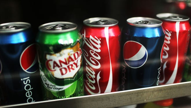 Charging extra for sugary drinks decreases the amount people buy, a new study shows.