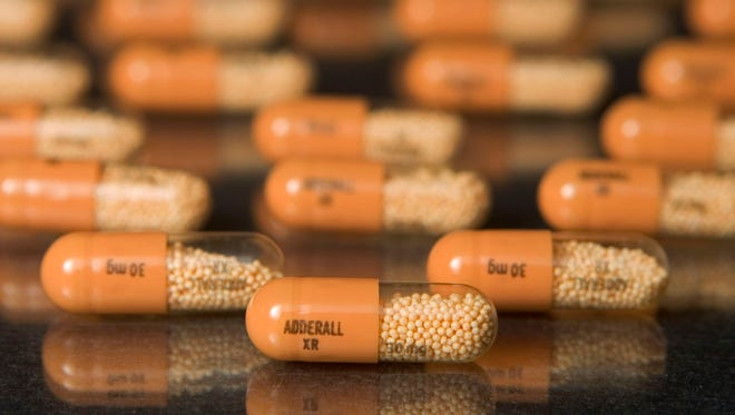 30mg tablets of Shire Plc's Adderall XR are arranged in a Cambridge, Massachusetts pharmacy.