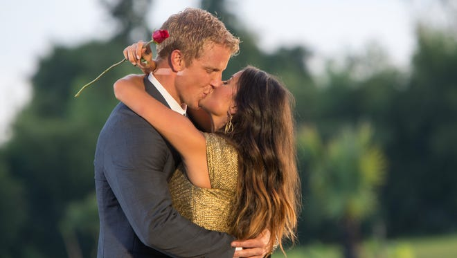 Sean Lowe and Catherine Giudici share a smooch on their engagement day in Thailand, Nov. 17, 2012.