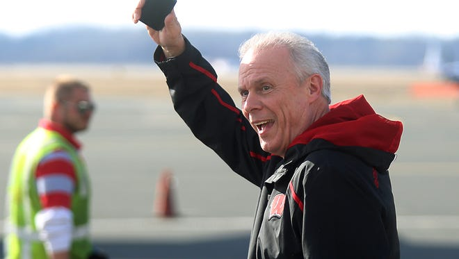 Wisconsin coach Bo Ryan acknowledges members of the media before boarding a flight Wednesday, April 2, 2014, in Madison, Wis.