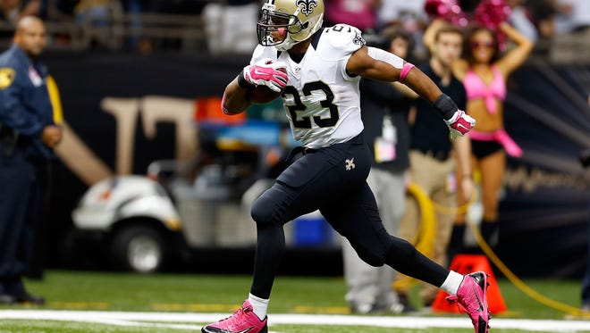 NEW ORLEANS, LA - OCTOBER 05:  Pierre Thomas #23 of the New Orleans Saints rushes for a touchdown during the fourth quarter of a game against the Tampa Bay Buccaneers at the Mercedes-Benz Superdome on October 5, 2014 in New Orleans, Louisiana.  (Photo by Wesley Hitt/Getty Images)