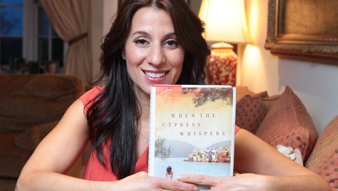 "Yvette Corporon is photographed April 10, 2014 at her home in Bronxville. Corporon, a senior producer at EXTRA, wrote a book called ""When the Cypress Whispers,"" a novel based on a true story about an entire town in Greece that safe-harbored a Jewish family during the Holocaust."