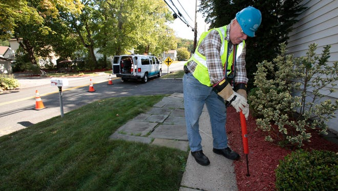 Bobby O'Brien, a senior electrical technician with Consolidated Edison, punches a sampling hole, checking a gas line from the street to a home owners house in North White Plains on Sept. 18, 2014. Con Ed, using a specially equipped  vehicle called the Mobile Leak Detector,  was checking recent repair work in the area.