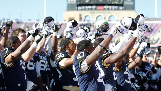 Players of the Navy Midshipmen shown in December.