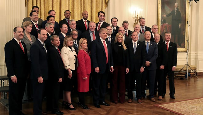 President Trump poses for a photo with members of the National Association of Attorneys General in the East Room at the White House on Feb. 28, 2017.