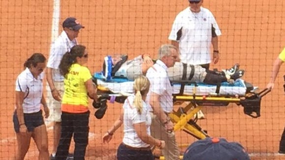 Auburn catcher Carlee Wallace is taken off the field on a stretcher following a collision with South Alabama's Amanda Minahan in the fourht inning of Sunday's NCAA Regional final.