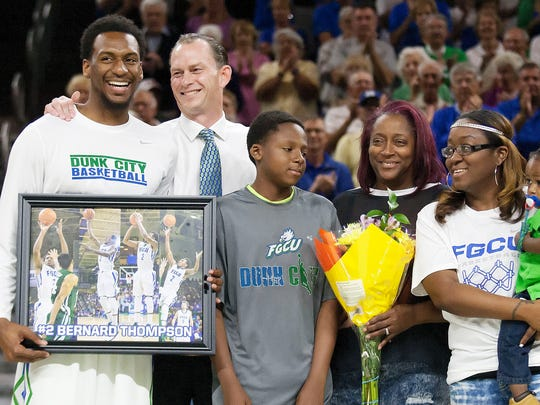 FGCU's Bernard Thompson, left, was one of five Eagles seniors honored Wednesday at Alico Arena. Coach Joe Dooley, second from left, and Thompson's family stood with Thompson during a pregame ceremony.