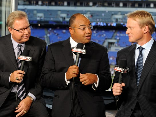 Mike Tirico, center, will leave ESPN in late June.