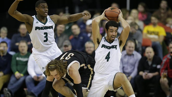 At right, UW-Green Bay's Jordan Fouse (4) looks to make a pass after stealing the ball away from UW-Milwaukee's Matt Tiby (31) in the first half during Monday night's Horizon League game at the Resch Center in Ashwaubenon. UW-Green Bay's Khalil Small (3) is also shown on the play.