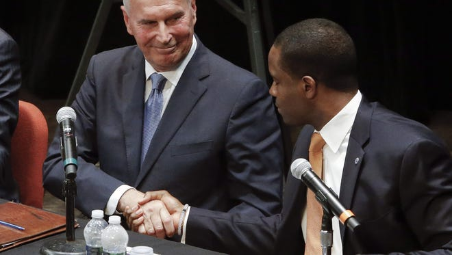 Wilmington mayoral candidates Mike Purzycki (left) and Eugene Young shake hands after debate on May 26. Young fell just 234 votes short of Purzycki in the mayor's race Tuesday.