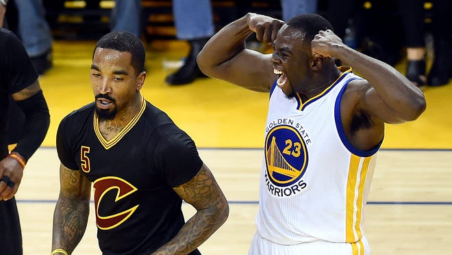 Golden State Warriors forward Draymond Green (23) reacts after a play against Cleveland Cavaliers guard J.R. Smith (5) during the second quarter in Game 7of the NBA Finals at Oracle Arena.