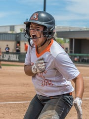 Aztec's Kylie Brown celebrates after scoring a run against Artesia in the 5A softball championship on Saturday in Albuquerque.