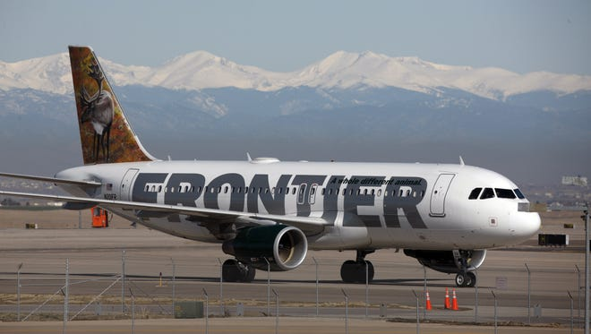 FILE - In this Thursday, April 8, 2010 file photo, a Frontier Airlines jetliner arrives at Denver International Airport.