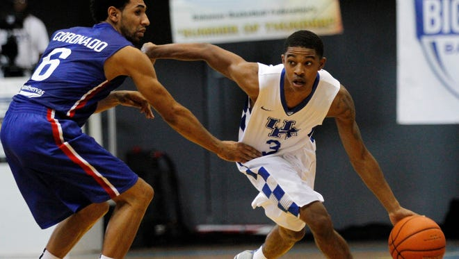 University of Kentucky's Tyler Ulis drives up court against Juan Coronado during the team's exhibition game against the Dominican Republic national team in Nassau, Bahamas. August 15, 2014.