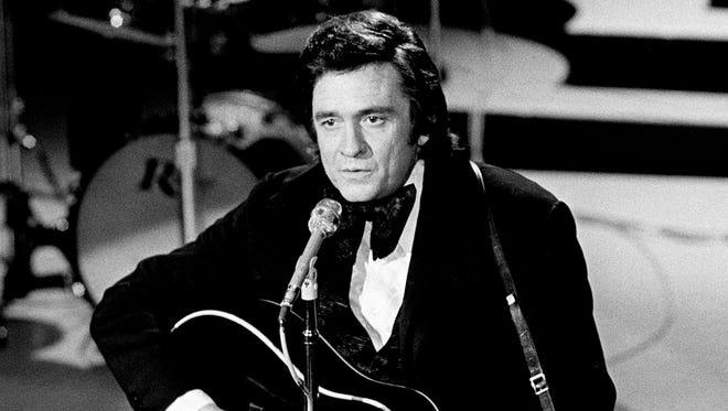 Johnny Cash performs at the Grand Ole Opry House on Oct. 15, 1973.
