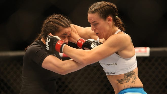 Rosi Sexton, left, fights Alexis Davis during their  bantamweight bout at UFC 161. Sexton was thoroughly beaten by Jessica Andrade this weekend in England and said the reaction to her fight was sexist