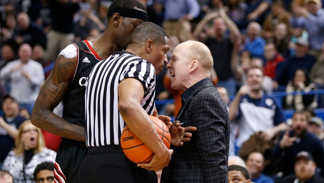 Cincinnati Bearcats head coach Mick Cronin talks to an official as his team takes on the Connecticut Huskies in the second half at XL Center. UConn defeated the Cincinnati Bearcats 51-45.