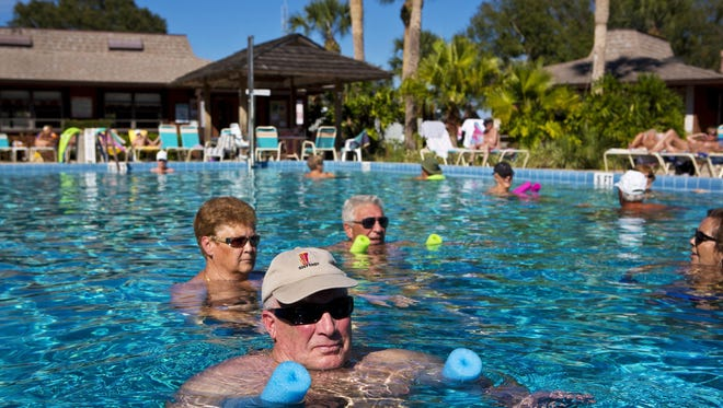 Jim Walker, from upstate New York, relaxes in one of the swimming pools at Cypress Cove Nudist Resort & Spa, Feb. 19, 2014. The nudist resort in Kissimmee celebrates its 50th anniversary this year.
