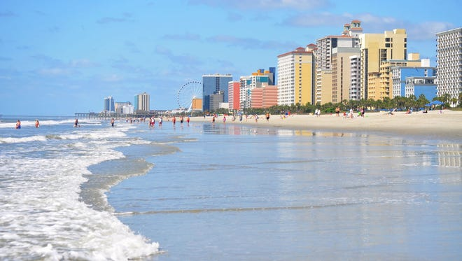 Who can resist 60 miles of beach?