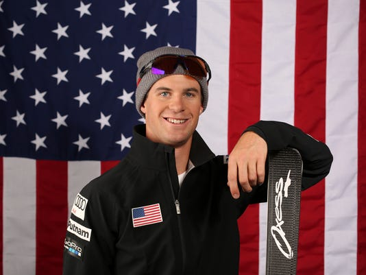 """FILE - This is a Wednesday, Sept. 27, 2017 file photo of U.S. Olympic Winter Games freestyle skiing aerials hopeful Mac Bohonnon  as he poses for a portrait at the 2017 Team USA media summit  in Park City, Utah. American freestyle skier Mac Bohonnon will pay tribute to one of his sport's most fascinating and beloved characters if the conditions are right. And if that goes well he might find himself with an Olympic medal hanging around his neck, too. Bohonnon has been working on the """"Hurricane,"""" the same trick the late Speedy Peterson landed eight years ago to win his silver medal in aerials. (AP Photo/Rick Bowmer/ File)"""