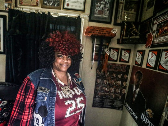 Terrie Wimberly, mother of Ron Patterson, poses for