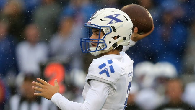 St. Xavier quarterback Chase Wolf (2) throws in the first quarter during the high football game between the St. Xavier Bombers and the Colerain Cardinals, Friday, Sept. 1, 2017, at Colerain High School in Colerain Township.