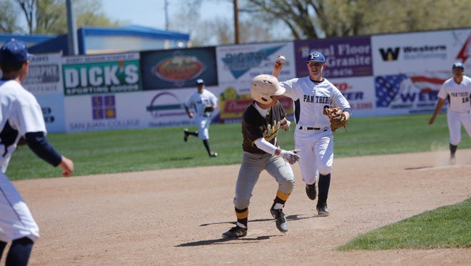 Piedra Vista's Cody McGaha looks to pick off Cibola's Dylan Childs approaching third base during a District 1-6A baseball game on Saturday, April 14 at Ricketts Park. McGaha is one of three Panthers who will play in this year's 5A/6A All-Star series on June 8 and 9 in Las Cruces.