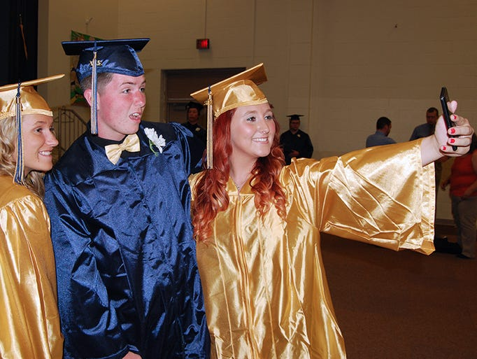 From left, Katie Sebastian of Erlanger, Kenny Hayes of Independence and Bobbie Williams of Erlanger pose for a selfie prior to the Lloyd Memorial High School graduation May 30.