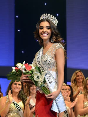 Miss Michigan USA 2014 Elizabeth Ivezaj walks the stage for the first time after taking her crown September 2013 during the Miss Michigan USA pageant at McMorran Auditorium. The winner will represent the State of Michigan and compete for the title of Miss USA.