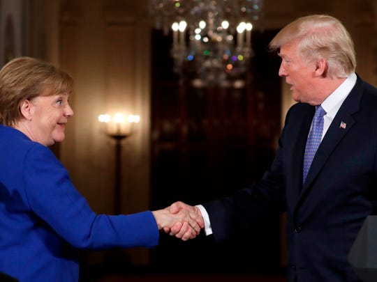 President Donald Trump shakes hands with German Chancellor