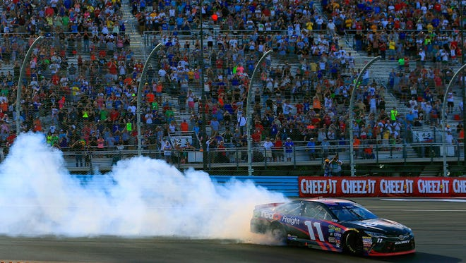 Denny Hamlin celebrates with a burnout after winning the Cheez-It 355 at The Glen.