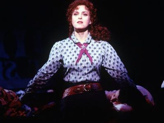 "Actress Bernadette Peters, shown in a 1999 promotional photo, performs the title role in ""Annie Get Your Gun."""