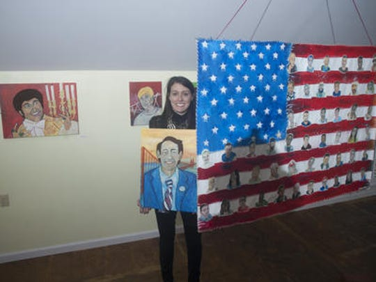"""Maple Shade art teacher Jennifer Braverman poses with some of her artwork at the Eilandarts Center at The Station in Merchantville, where her work is on display as part of an exhibit called """"Invisible Identity."""""""