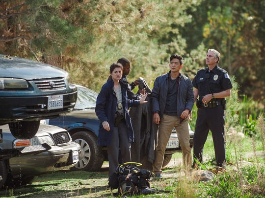 """Detective Vick (Debra Messing) leads the investigation to find the missing daughter of David (John Cho) in """"Searching."""""""