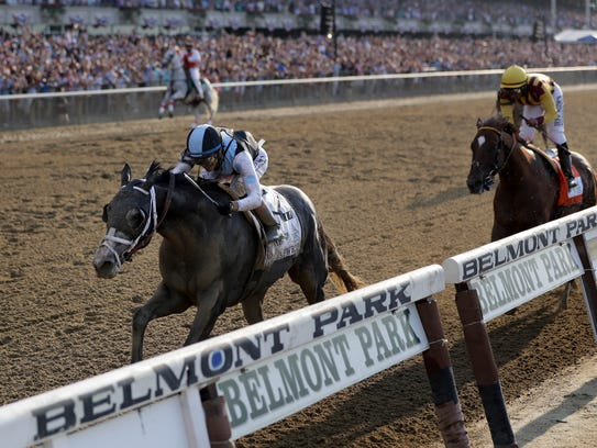 Tapwrit, ridden by Jose Ortiz, crosses the finish line