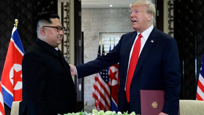 President Trump and North Korea leader Kim Jong Un after they signed documents at their Singapore summit on Tuesday, June 12, 2018.