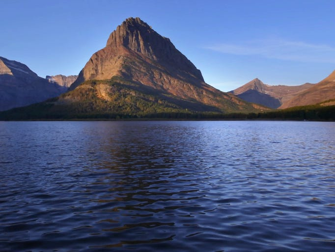 Swiftcurrent Lake and Grinnell Point catch the morning