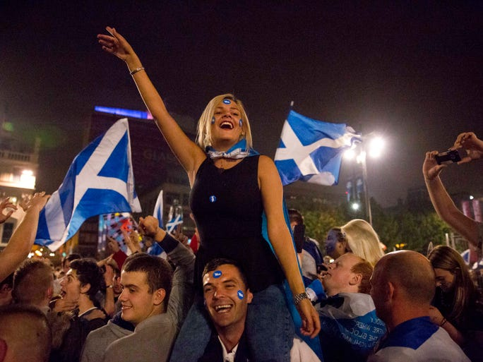Supporters of the Yes campaign in the Scottish independence referendum shout and cheer as they await the result in George Square, Glasgow, Scotland, late Thursday, Sept. 18, 2014.  From the capital of Edinburgh to the far-flung Shetland Islands, Scots embraced a historic moment - and the rest of the United Kingdom held its breath - after voters turned out in unprecedented numbers.