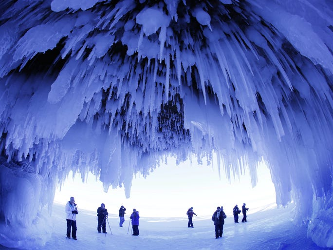 People visit the caves at Apostle Islands National Lakeshore in northern Wisconsin, transformed into a dazzling display of ice sculptures by the arctic siege gripping the upper Midwest.