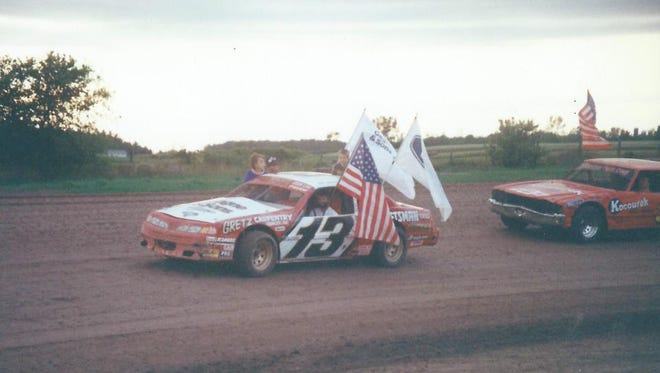 Kewaunee's John Gregorich scored 23 features and won IMCA's national stock car crown in 1993. He's shown during the parade lap at Luxemburg Speedway.