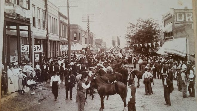 This first one is of a Street Fair on Main Street. Ash Grove had street fairs In October for many years beginning at the  turn-of-the century.  This photo is not dated, but is guessed to be around 1907. The photo depicts the judging of horses.