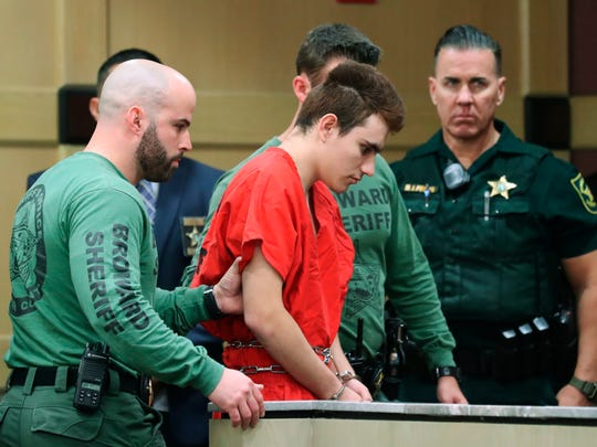 In this March 14, 2018 photo, Nikolas Cruz is led into