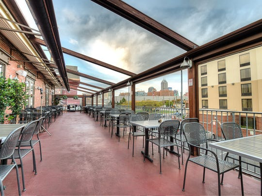 The second-level deck at Tavern on South offers views of the Indianapolis Skyline.