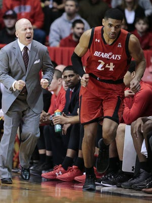 UC head coach Mick Cronin yells at forward Kyle Washington as he checks into the game in the first half.