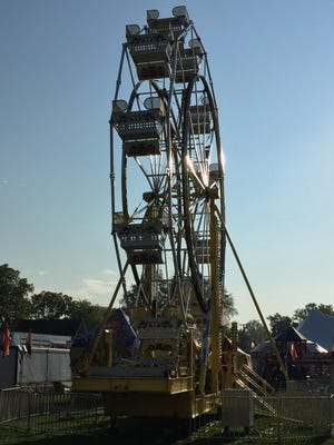 A Ferris wheel stands silhouetted against a cloudless sky. St. Mary's Fall Festival continues in St. Clair today.