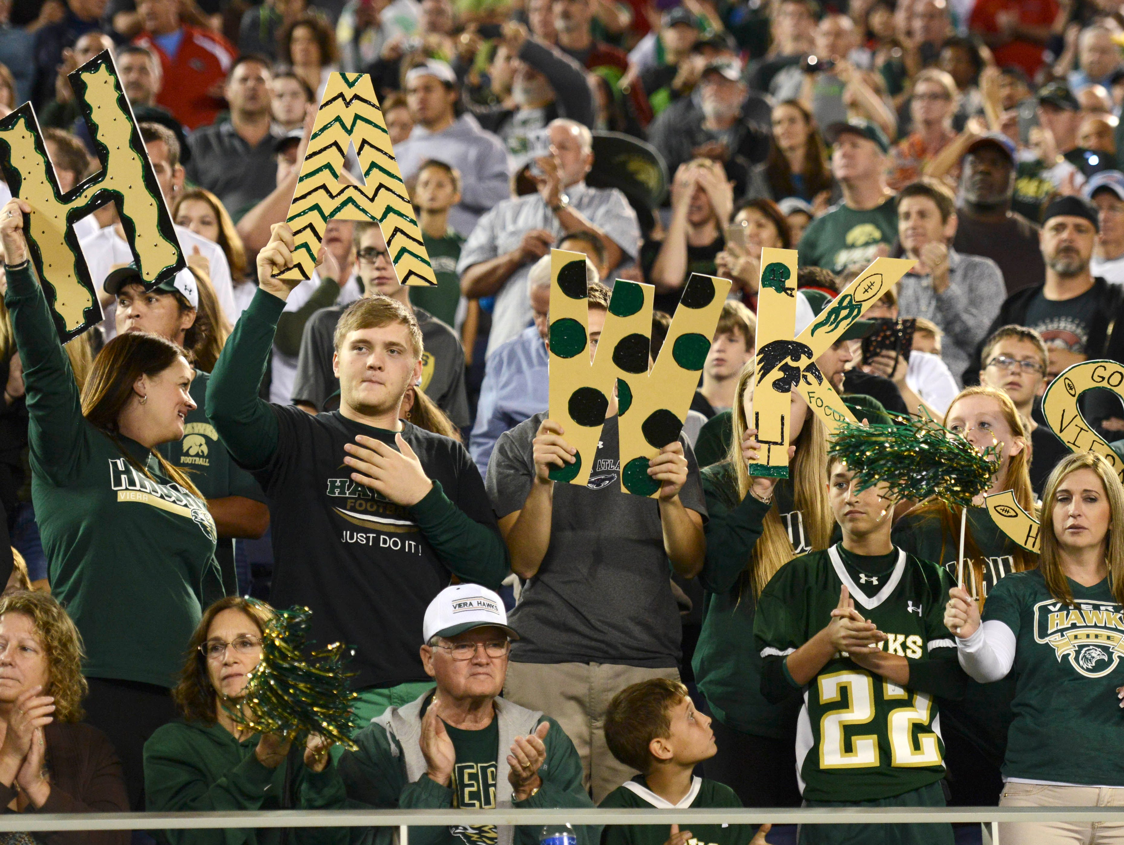 Fans cheer for the Hawks during Friday's game in the Orlando Citrus Bowl.