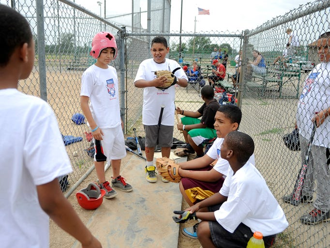 Kids prepare for their baseball game against the St. Cloud Police Department at Whitney Park on August 9. St. CloudÕs Youth Coalition planned the event which also had food and drinks for the youth participating.