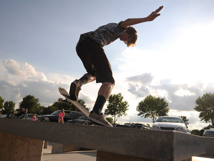 Ryan Wood 20, does a nose grind Friday during the first Granite City Grind at the St. Cloud Skate Plaza.The event featured vendors, prizes for winners, live music and competitions for skaters.