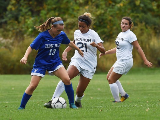 Beacon's Katelyn Rosa, center, tries to regain possession