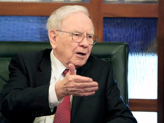 FILE - In this May 4, 2015 file photo, Berkshire Hathaway Chairman and CEO Warren Buffett speaks during an interview with Liz Claman on the Fox Business Network in Omaha, Neb. Berkshire Hathaway reports quarterly financial results on Friday, Aug. 7, 2015.